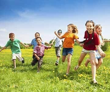 smiling children running in open field